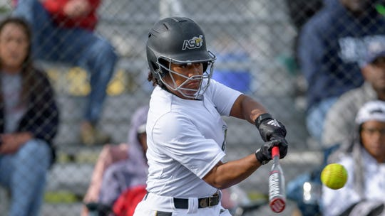 Alabama State outfielder Alexis Sydnor swings during an NCAA softball game against Southern University on Saturday, March 7, 2020, in New Orleans. (AP Photo/Matthew Hinton)