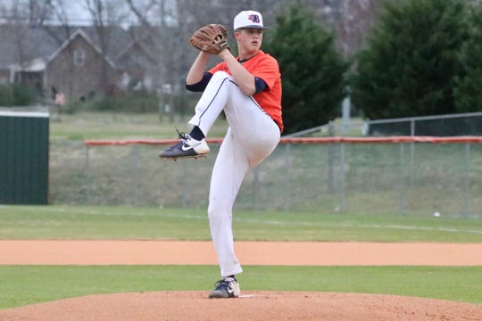 Blackman's Drew Beam fires a pitch during Monday's season opener. Blackman defeated Oakland 3-2 as Beam earned the win.