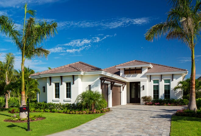 Divco Custom Homes' beautiful Senza model is located on a lakefront homesite in Miromar Lakes.
