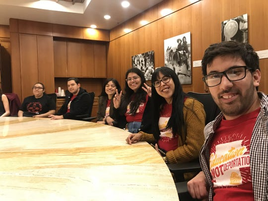 Immigrant youth attend the signing of Senate Bill 137 into law during the 2020 New Mexico legislative session.