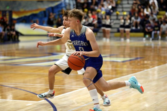 Riley Hestand drives by a Santa Fe defender in their first round 5A tournament game on March 7, 2020.