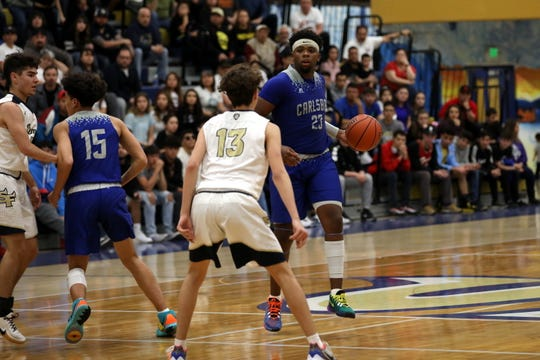 Highlights from Carlsbad's 5A state opening round match against Santa Fe High on March 7, 2020. Santa Fe won,  59-45.