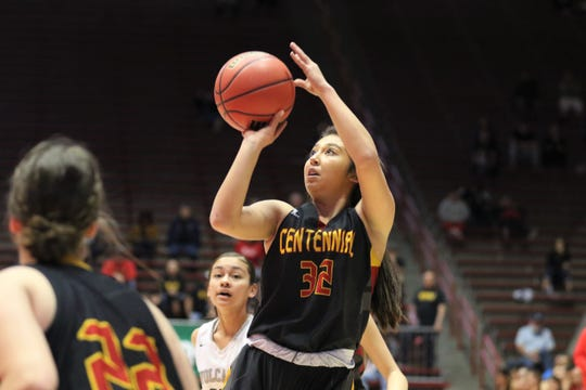Centennial's 	Larissa Laborin fires a mid-range jumper against Volcano Vista during Tuesday's NMAA 5A girls basketball state quarterfinals game at Dreamstyle Arena in Albuquerque.