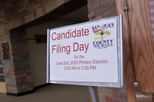 A sign directs candidates to the county clerk's office, Tuesday, March 10, 2020, to file paperwork in Aztec.