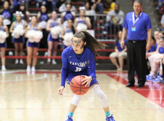 Carlsbad's Baylee Molina looks to drive inside toward the basket against Hobbs during Tuesday's NMAA 5A girls basketball state quarterfinals game at Dreamstyle Arena in Albuquerque.