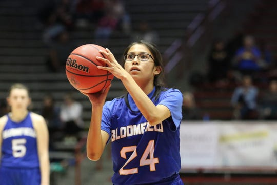 Bloomfield's Chenoa Toledo shoots a free throw against Los Lunas' Kylee Trujillo during Tuesday's NMAA 4A girls basketball state quarterfinals game at Dreamstyle Arena in Albuquerque.