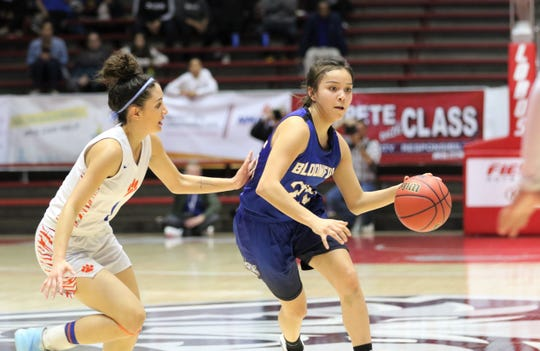 Bloomfield's Madison Bedonie drives toward the basket against Los Lunas' Kylee Trujillo during Tuesday's NMAA 4A girls basketball state quarterfinals game at Dreamstyle Arena in Albuquerque.