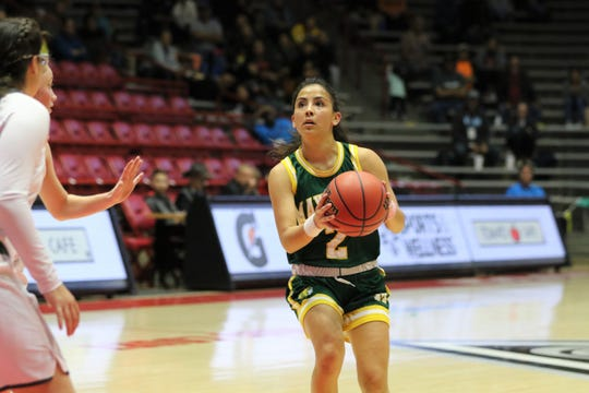 Mayfield's Margarita Salas looks to get a shot off against La Cueva during Tuesday's NMAA 5A girls basketball state quarterfinals game at Dreamstyle Arena in Albuquerque.