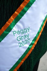Gray's sash has her name and the year of the St. Patrick's Day parade she'll be marshalling.
