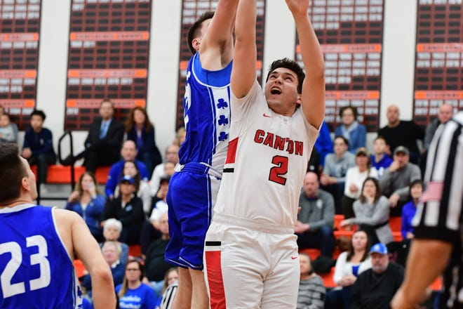 Canton's Sean Mullen goes up for a rebound against CC.