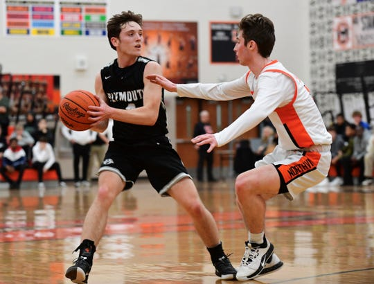 Plymouth's Ethan Bentley is guard by Northville's Brady Withey.