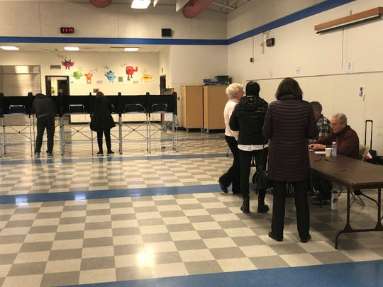 Voters at Pierce Elementary School in Birmingham prepare to cast their ballots in the presidential primary election on March 10, 2020.