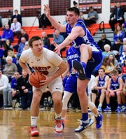 Canton's Jake Vickers is guarded by Catholic Central's Cooper Craggs.