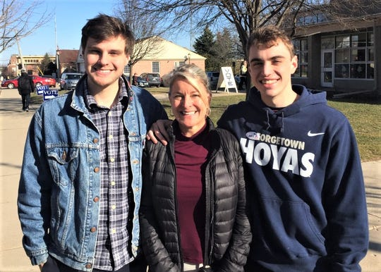 Three members of Northville's Evans family -- from left, Jack, Kristin and David -- voted together Tuesday afternoon.
