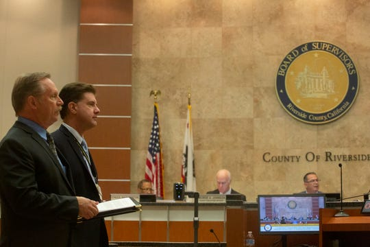 From left, Bruce Barton, County Director of Emergency Management and Cameron Kaiser, Riverside County Public Health Officer speak about what the county is doing in response to COVID-19 in the county during a county supervisor board meeting on Tuesday, March 10, 2020.