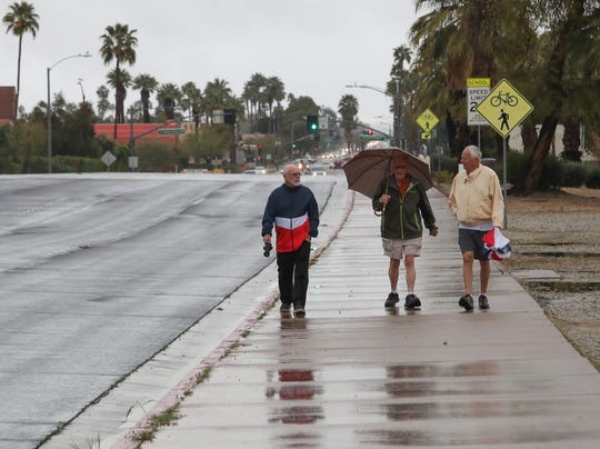 From left, John Ryan, Lee Salem and Bob Swanson walk along Sunrise Dr. in Palm Springs, March 10, 2020.