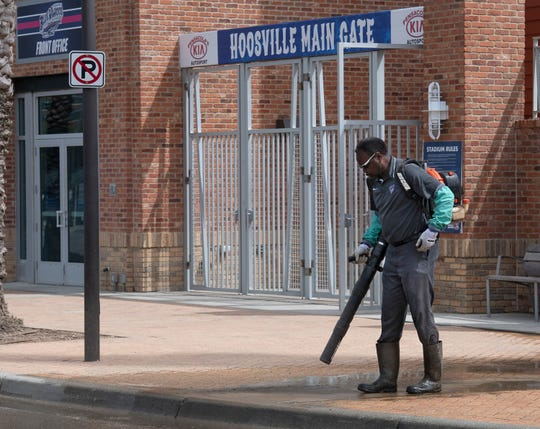 Michael Crenshaw spends Tuesday, March 10, 2020, cleaning and pressure washing the outside of the Blue Wahoos Stadium for the upcoming baseball season. With the season postponed, Blue Wahoos Stadium is set to be the site of a medical supply drive in response to the coronavirus pandemic.