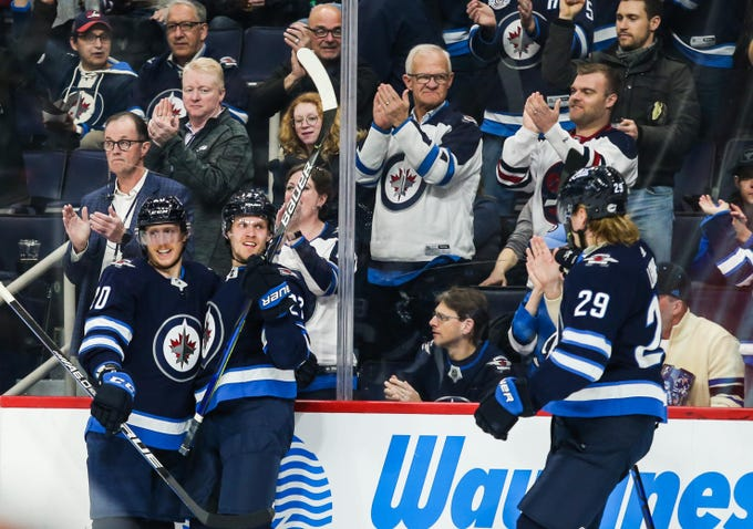 Mar 9, 2020; Winnipeg, Manitoba, CAN;  Winnipeg Jets forward Nikolaj Ehlers (27) is congratulated by his team mates on his goal against the Arizona Coyotes during the second period at Bell MTS Place. Mandatory Credit: Terrence Lee-USA TODAY Sports
