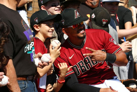 Arizona Diamondbacks infielder Eduardo Escobar poses for a picture with fans during a Cactus League game on Mar. 9, 2020 at Salt River Fields at Talking Stick in Scottsdale, Ariz.