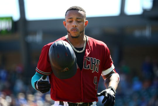 Arizona Diamondbacks Ketel Marte flips his helmet after flying out to center against the Kansas City Royals in the first inning during a Cactus League game on Mar. 9, 2020 at Salt River Fields at Talking Stick in Scottsdale, Ariz.