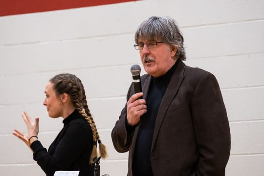 Gene Harrison, owner of Wings Etc. in Port Huron, talks during an assembly at Indian Woods Elementary Monday, March 9, 2020. The franchise has partnered with local schools for a new reading program.