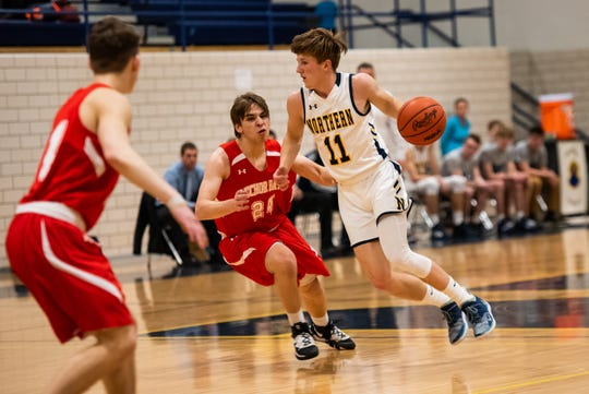 Anchor Bay's Ethan Ansted (24) defends against Northern's James DeLong during their Division 1 pre-district match Monday, March 9, 2020, at Port Huron Northern High School.
