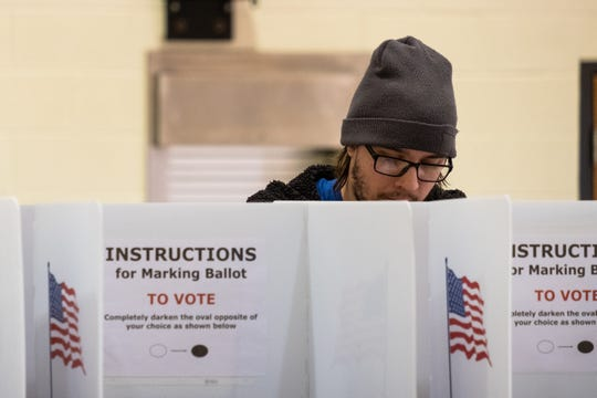 A resident fills out his ballot in the Michigan primary election at the precinct 7 polling location Tuesday, March 10, 2020, at the First United Methodist Church in Port Huron.