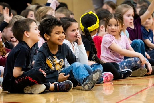 Kids listen during an assembly Monday, March 9, 2020, at Indian Woods Elementary.