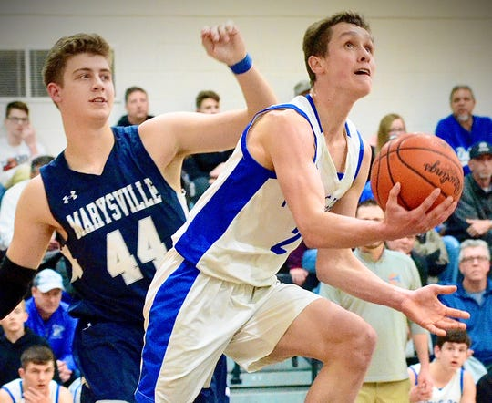 Croswell-Lexington's Hunter Soper attempts a layup against Marysville during a Division 1 boys basketball pre-district game on Wednesday, March 9, 2020, at Armada.