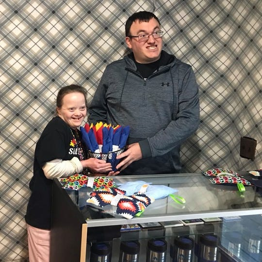 Simply Silverware employees Milinda Brewington, 34, and Patrick Myers, 30, pose for a photo after finishing a customer's order in St. Clair on March 3, 2020.