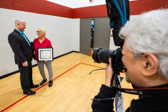 Indian Woods principal Kathy Kish, right, talks with Port Huron Area Schools Superintendent Jamie Cain before having a photo taken Monday, March 9, 2020, after an assembly at Indian Woods.