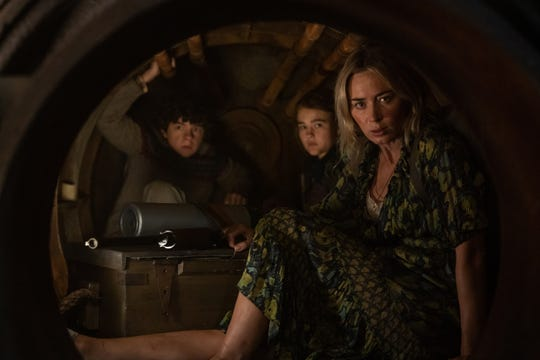 """L-r, Marcus (Noah Jupe), Regan (Millicent Simmonds), and Evelyn (Emily Blunt) in """"A Quiet Place Part II."""""""