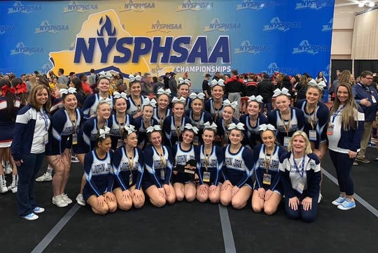 The John Jay cheerleading team poses together at the state championships after taking third place in the tournament in Rochester on March 7.