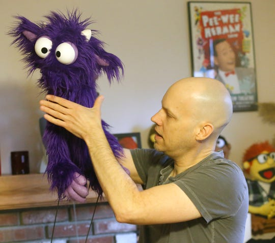 David Manley demonstrates how he brings his puppets to life while at his home in the Town of Newburgh on March 10, 2020.