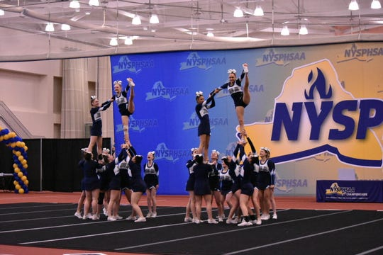 The John Jay cheerleading team performs its routine in the finals of the state cheerleading tournament in Rochester on Saturday.