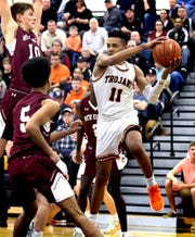 York Suburban's Savon Sutton looks for a pass with New Oxford's Thomas Haugh and Tayshawn Golden, center, defending during a PIAA Class 5-A second-round boys' basketball game at Red Lion Tuesday, March 10, 2020. Bill Kalina photo