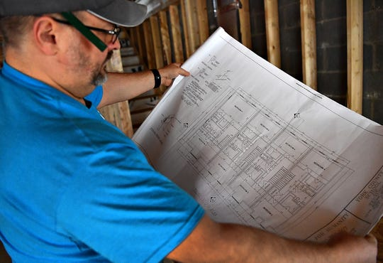 Construction Manager Brad Anderson looks at the plans for the third floor of the Habitat for Humanity property at 701 Chestnut Street in York City, Tuesday, March 10, 2020. Dawn J. Sagert photo