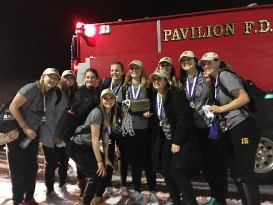 Members of the Pavilion girls basketball team pose with the Section V Class D1 trophy. Pictured are, front: Karlee Zinkievich, Kodi Beehler. Back: Paige Landers, Adeline Milligan, Emily Hoag (videographer), Lauren Kingsley, Lindsay Lowe, Shea Amberger, Sydney Finch, Emily Kingsley.