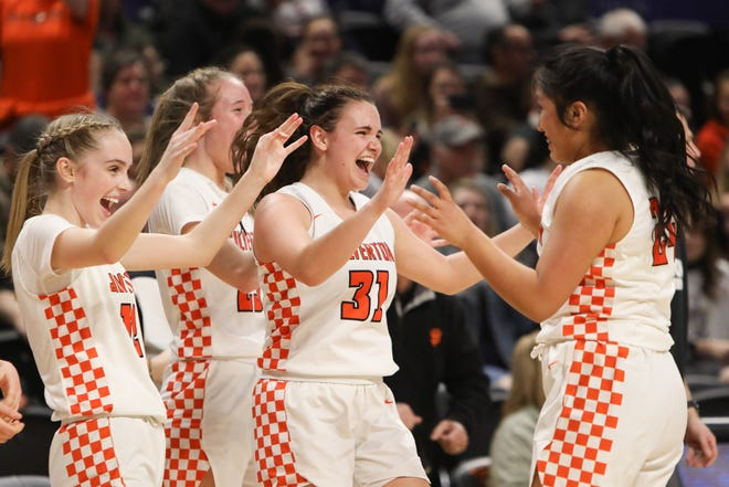 From left: Paige Traeger, Truitt Reilly, Josslyn Ames and Abigail Espinavarro celebrate following their 73-26 win over Ridgeview in the 5A Girls Basketball State Championship quarterfinal game on Tuesday, March 10 at Gill Coliseum in Corvallis, OR.