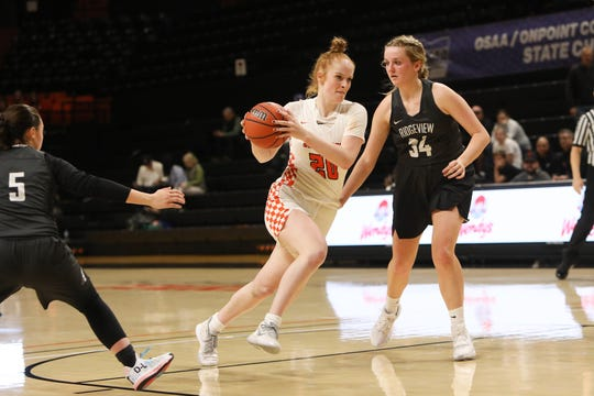 Silverton's Riley Traeger drives to the basket in the 5A Girls Basketball State Championship quarterfinal game against Ridgeview on March 10 at Gill Coliseum in Corvallis, OR.