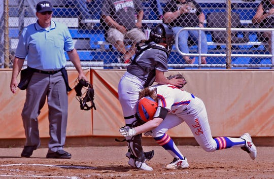 Ashton McMillan, lower right, crashes into the Abilene catcher trying to score a run for Central on Tuesday, March 10, 2020.