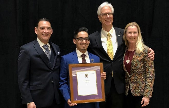From left: Dr. Javier Flores, Angelo State University Vice President for student affairs and enrollment management; Cody Vasquez; Dr. Clifton Jones, dean of ASU Norris-Vincent College of Business; and Gayle Randall, ASU senior instructor in management and marketing.  Vazquez, a graduate student in business at ASU, was named the 2020 National Collegian of the Year by Beta Sigma Pi business fraternity.