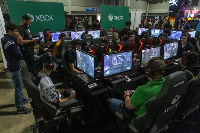 """Attendees take part in a Halo 3 video game competition during South by Southwest 2019. SXSW co-founder and CEO Roland Swenson told the Wall Street Journal that """"We are planning to carry on and do another event in 2021, but how we're going to do that I'm not entirely sure."""""""
