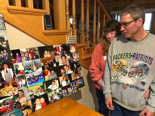 Randy and Tammy Kirsch look at photo boards from Michael Kirsch's funeral.