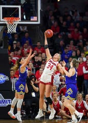 USD's Hannah Sjerven jumps over SDSU's Rylie Cascio Jensen and Paiton Burckhard to get the rebound during the Summit League championship game on Tuesday, March 10, at the Denny Sanford Premier Center in Sioux Falls.