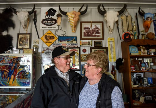A collection of bison memorabilia hangs behind Ed and Deanna Nolz on Sunday, March 8, 2020 at their bison ranch in northern Sioux Falls. The couple has been married for 59 years.