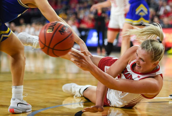 USD's Hannah Sjerven passes the ball to a teammate as she falls to the ground during the Summit League championship game against SDSU on Tuesday, March 10, at the Denny Sanford Premier Center in Sioux Falls.