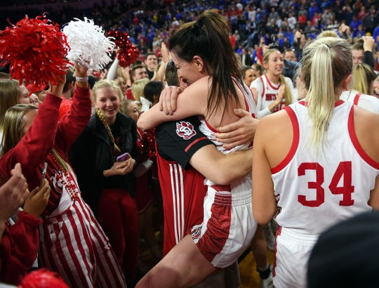 USD's Ciara Duffy jumps into the arms of a loved one while celebrating the team's Summit League championship win on Tuesday, March 10, at the Denny Sanford Premier Center in Sioux Falls.