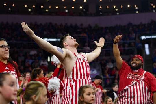 USD fans celebrate a three-pointer during the Summit League championship game on Tuesday, March 10, at the Denny Sanford Premier Center in Sioux Falls.