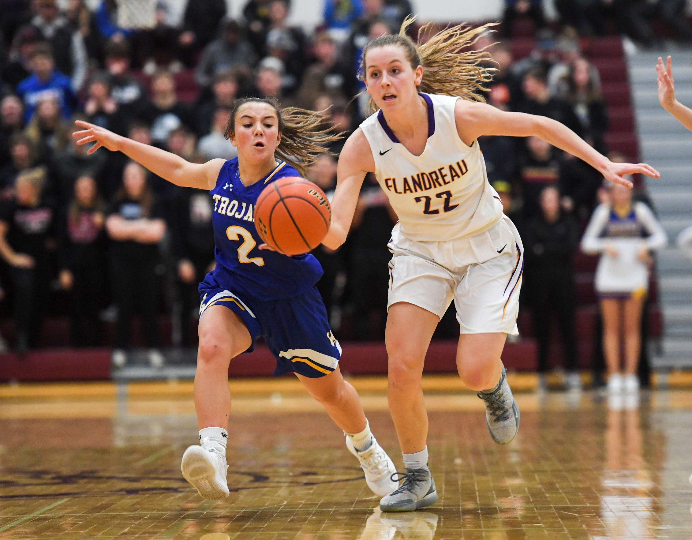 Flandreau's Hannah Parsley (22) drives the ball down the court during the SoDak 16 game against West Central on Monday, March 9, 2020 at Madison High School.